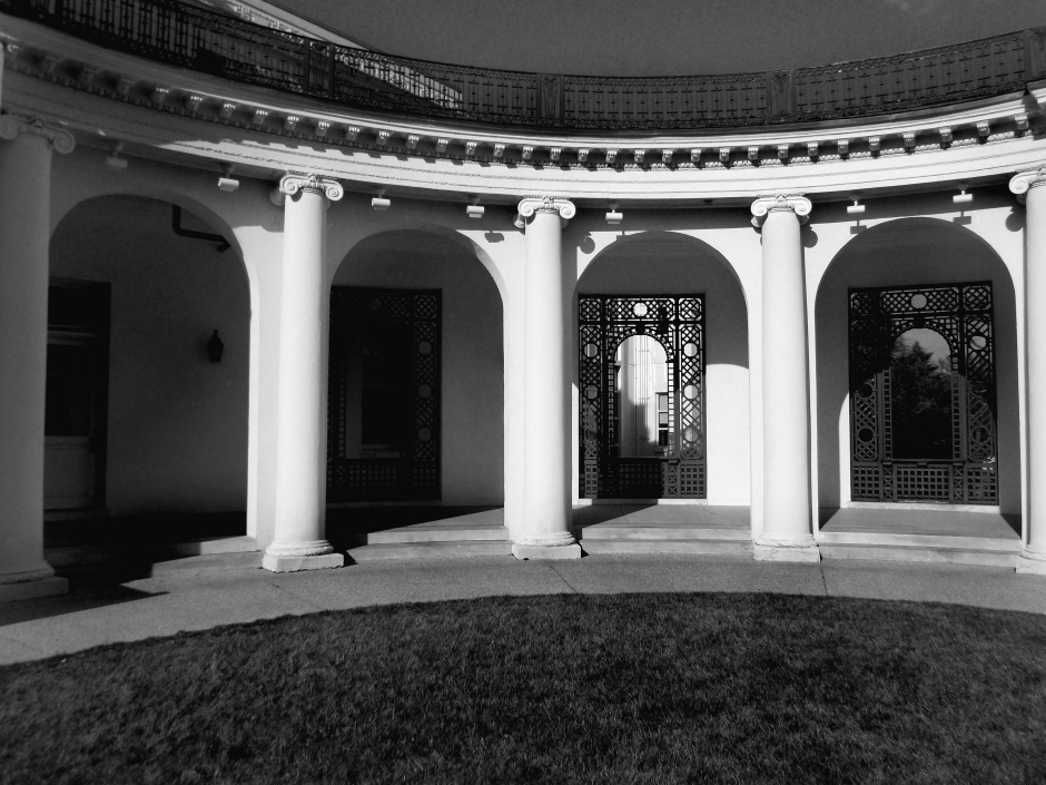 Arched arcade around courtyard of mansion