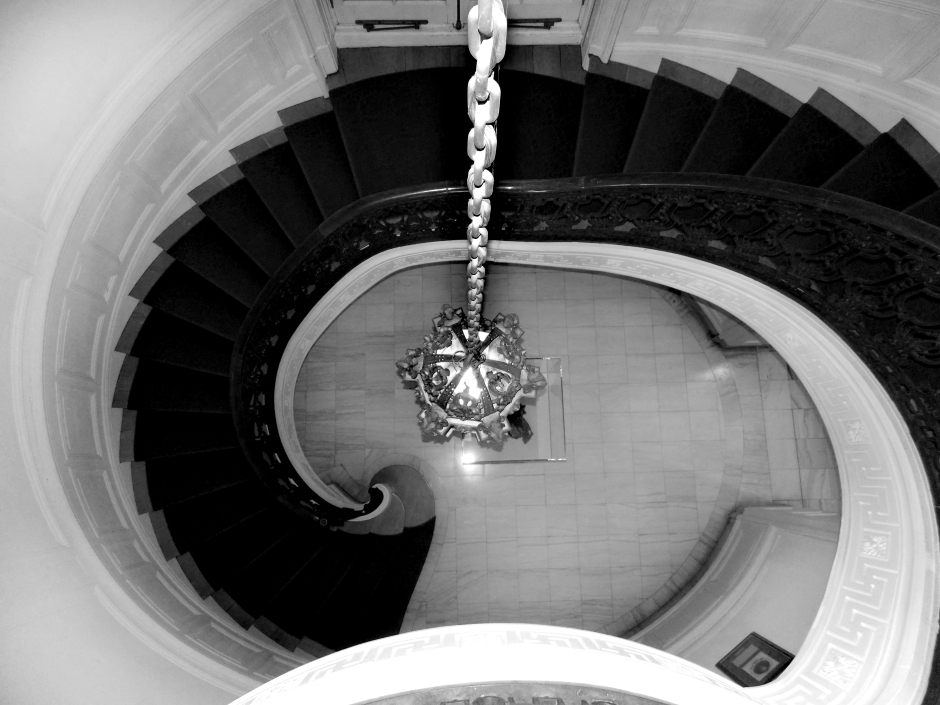Looking down the stairwell from the second floor balcony of Guggenheim Mansion