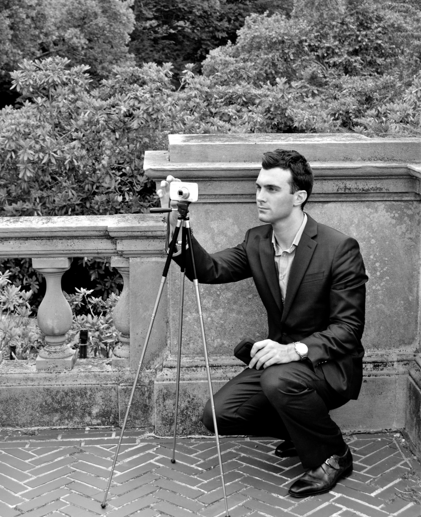 Photo of Matthew James photographing the south side of Westbury House. Taken by James Andrew.