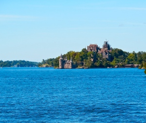 Boldt Castle and Power House in distance across St. Lawrence River.