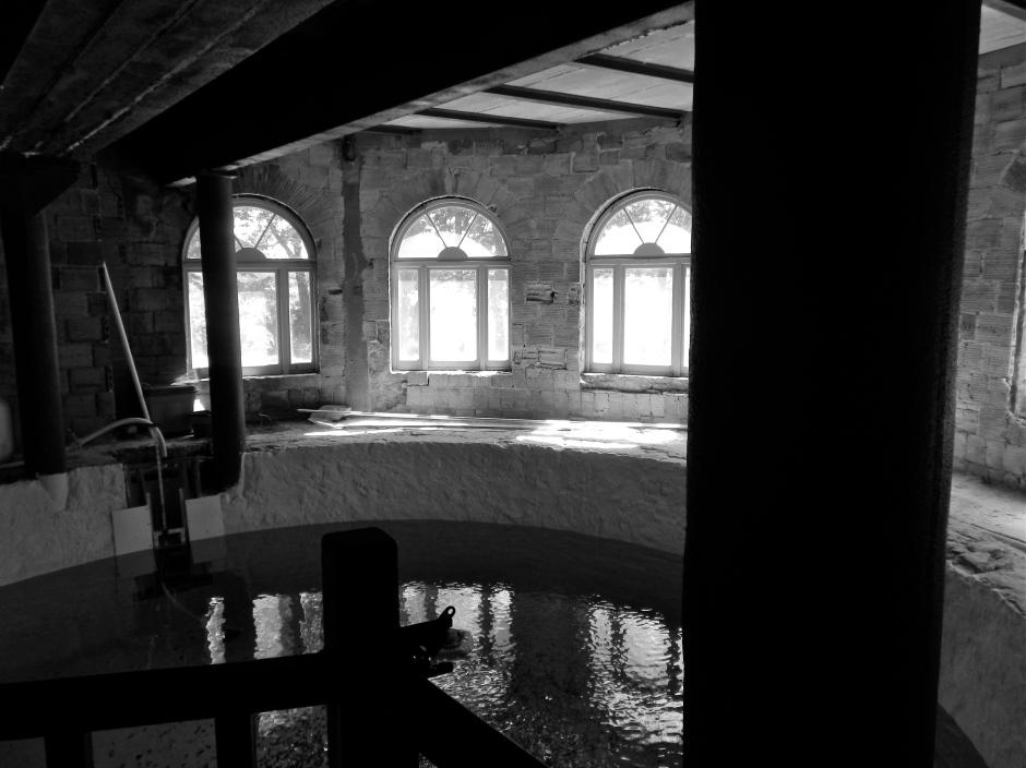 Unfinished pool in the basement level of the castle.