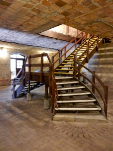 What would have been a formal staircase from the main floor to the basement level.