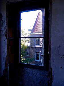 Photo looking out of fourth floor bedroom. An eerie reminder that while the house looks finished outside, it was left incomplete on that horrible day in 1904