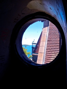 Porthole view from castle tower. St. Lawrence River in the background.