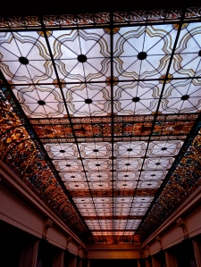 100-foot-long Venetian stained-glass ceiling over the Great Hall. The sun lights the colorful ceiling during the day, but at night 165 bulbs illuminate the magical window.
